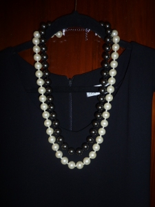 Same dress, with contemporary pearls.